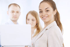 Portrait of smiling young business woman Stock Image