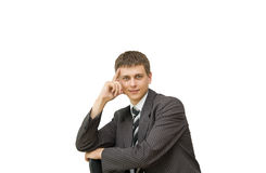 Portrait of a smiling young businessman. Isolated white background Royalty Free Stock Photography