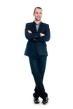 Portrait of a smiling young businessman full length against Stock Photo