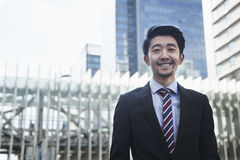 Portrait of smiling young businessman outdoors in Beijing, China Royalty Free Stock Photo