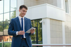 Portrait of smiling young businessman. Businessman working on his laptop. Handsome young man Stock Image