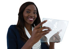 Portrait of smiling young businesswoman holding interface screen Royalty Free Stock Photography