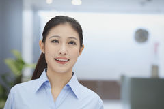 Portrait of smiling young businesswoman, indoors office, Beijing Royalty Free Stock Photo