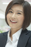 Portrait of Smiling Young Businesswoman, looking at camera Stock Photo