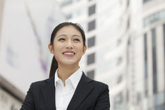Portrait of smiling young businesswoman, outdoors, Beijing, China Royalty Free Stock Photography