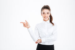 Portrait of a smiling young businesswoman pointing finger away Stock Photo