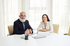 Portrait of smiling young businesswoman and senior in meeting Royalty Free Stock Images