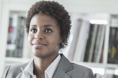 Portrait of smiling young businesswoman with short hair. head and shoulders Royalty Free Stock Images