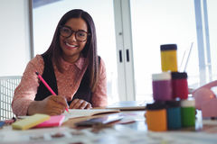 Portrait of smiling young businesswoman working at office Stock Photography