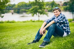 Portrait of smiling young man sitting on grass Stock Photography