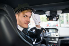 Portrait Of Smiling Young Chauffeur In Car Stock Photos