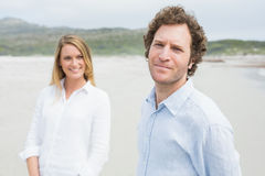 Portrait of a smiling young couple at beach Royalty Free Stock Photography