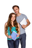 Portrait of smiling young couple with books Royalty Free Stock Photography