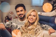 Smiling couple on christmas eve. Portrait of smiling young couple at home on christmas eve Stock Image