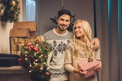 Smiling couple on christmas eve. Portrait of smiling young couple at home on christmas eve Royalty Free Stock Photos