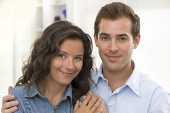 Portrait of smiling young couple at home Stock Images