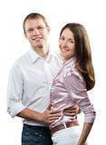 Portrait of smiling young couple Stock Photos