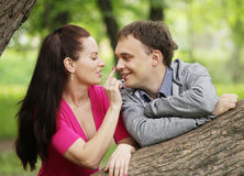 portrait of smiling young couple in love - Outdoors Stock Photo