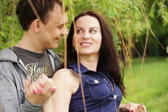 portrait of smiling young couple in love - Outdoors Stock Photography