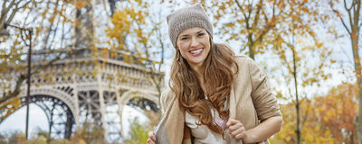 Portrait of smiling young elegant woman near Eiffel tower, Paris Royalty Free Stock Image