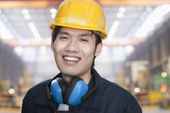 Portrait of Smiling Young Engineer in Yellow Hardhat Royalty Free Stock Images