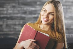 Smiling woman with book stock image