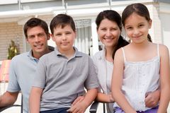 Portrait of smiling young family together Royalty Free Stock Photography