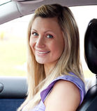 Portrait of a smiling young female driver Stock Photos