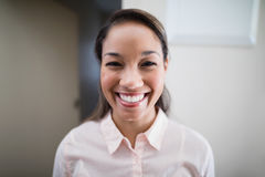 Portrait of smiling young female physiotherapist Royalty Free Stock Image