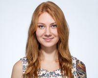Portrait of a smiling young ginger woman  with natural make up Royalty Free Stock Photo