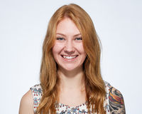 Portrait of a smiling young ginger woman  with natural make up Royalty Free Stock Image
