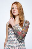 Portrait of a smiling young ginger woman showing tattoo on the h Stock Images