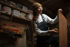 Portrait of smiling young girl carpenters in workshop room stock photography