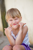 Portrait of smiling young girl Stock Photo