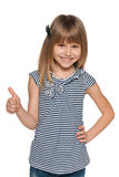 Smiling young girl with her thumb up Stock Photos