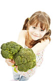 Portrait of a smiling young girl holding broccoli Royalty Free Stock Image
