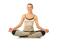 Portrait of smiling young girl practicing yoga Royalty Free Stock Photo