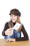Portrait Of Smiling Young Girl Showing A Red Heart Ace, The Trump Card, Half-Length Studio Shot Isolated On White Royalty Free Stock Image