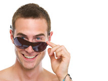 Portrait of smiling young guy with sunglasses royalty free stock images
