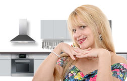 Portrait of smiling young housewife in modern kitchen Stock Images