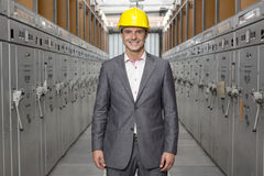 Portrait of smiling young male supervisor standing in control room Royalty Free Stock Photo