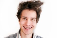 Portrait of a smiling young man. Isolated over white Royalty Free Stock Photos