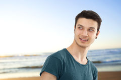 Portrait of smiling young man on beach Stock Photography