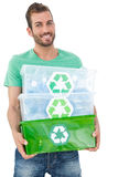 Portrait of a smiling young man carrying recycle containers Stock Photos