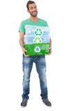 Portrait of a smiling young man carrying recycle containers Royalty Free Stock Images