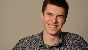 Portrait of a smiling young man stock video footage