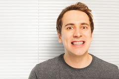 Portrait of smiling young man with dental braces Stock Photo