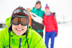 Portrait of smiling young man with friends in background during winter Stock Photo