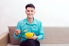 Man with corn flakes Stock Photography