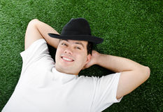 Portrait of smiling young man in hat Royalty Free Stock Photo
